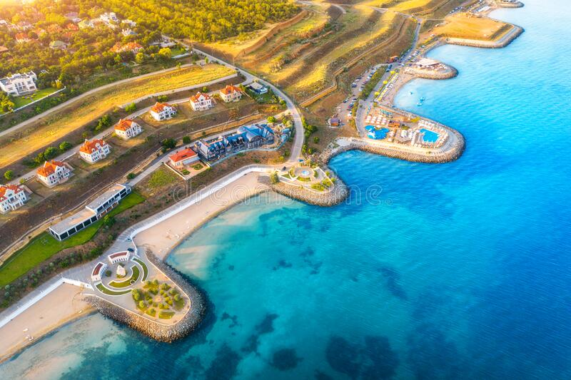 Aerial view of beautiful sandy beach and cottage town stock image