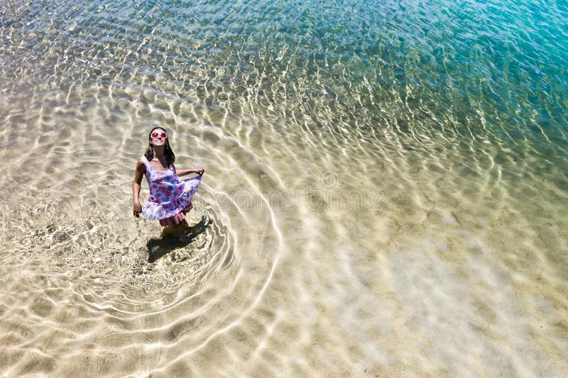 Aerial view of a woman in the sea stock images