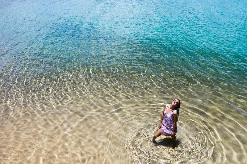 Aerial view of a woman in the sea royalty free stock photos