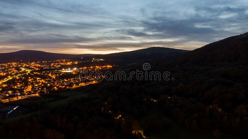 Aerial view of Belfast  in Northern Ireland at Night. Sunset above City, mountains or hills on background.  stock image