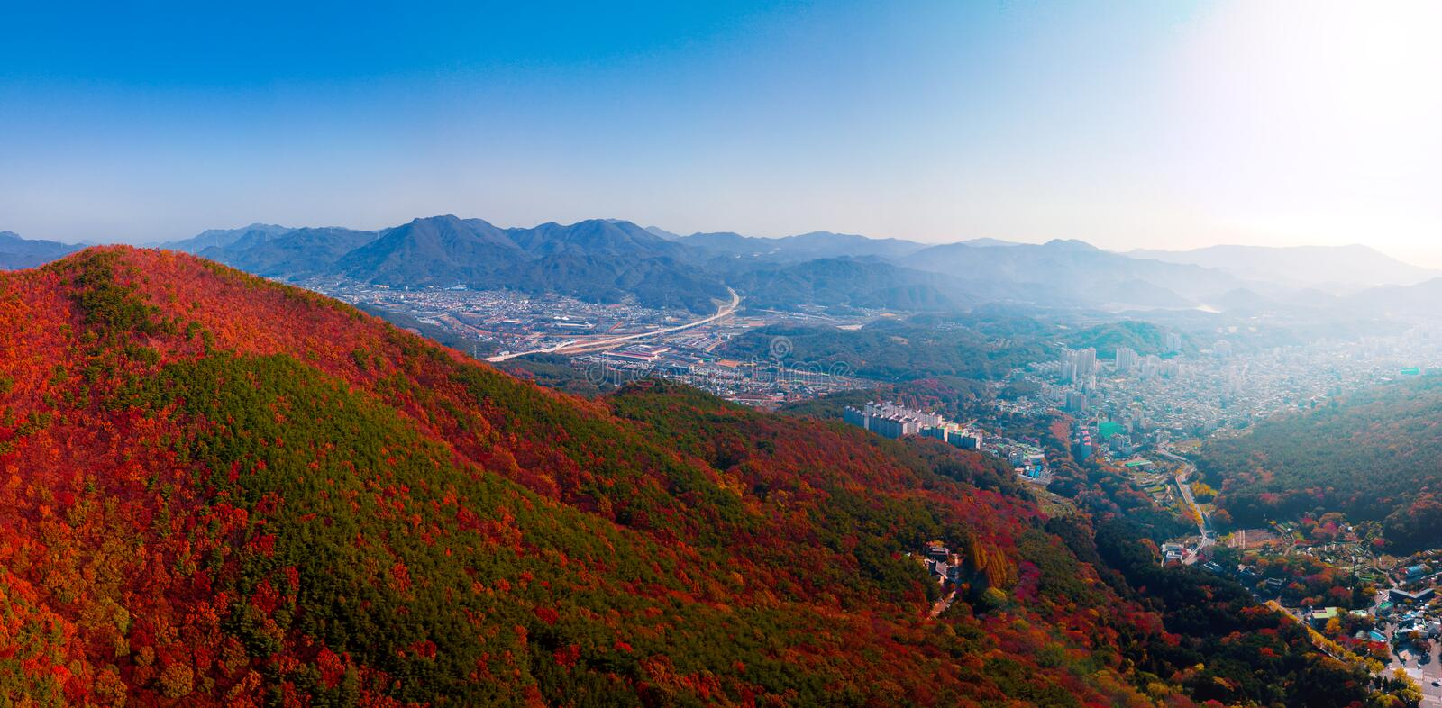 Aerial view of Beomeosa temple in Busan South korea.Image consists of temple located between the mountain covered with colorful. Trees royalty free stock photo