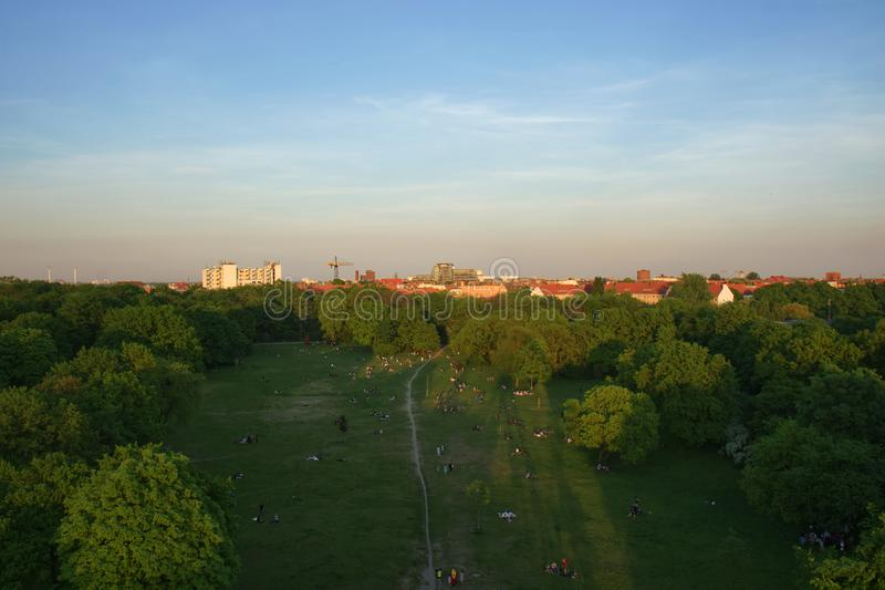 Aerial View of Berlin Park Hasenheide in Kreuzberg on an Spring afternoon with people relaxing and having fun on a large meadow in royalty free stock image