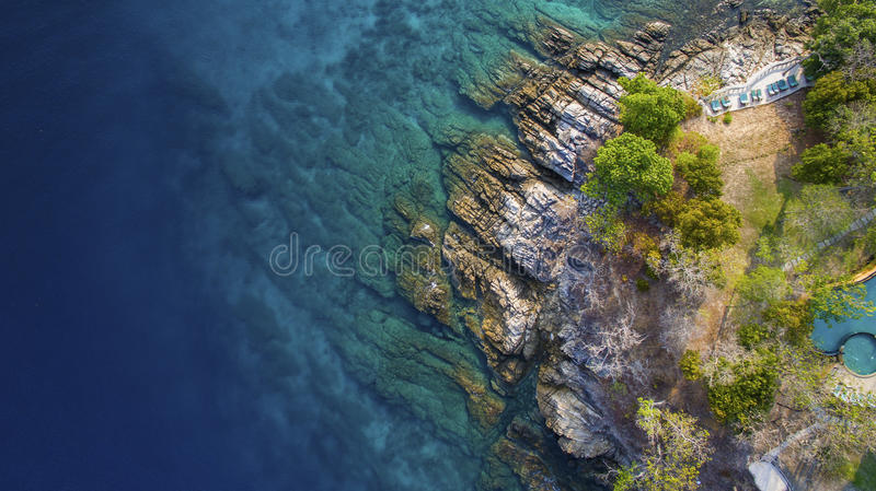 Aerial view of beuatiful blue ocean and rock coastal in phuket s stock photo