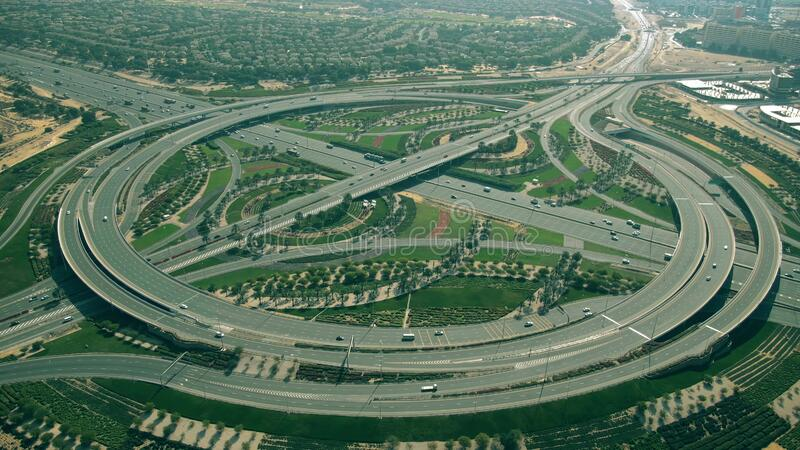 Aerial view of a big beautiful green highway interchange. Dubai, UAE. Aerial shot of a big highway interchange traffic royalty free stock images