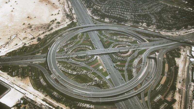 Aerial shot of a big round highway interchange in Dubai, United Arab Emirates. Aerial view of a big highway interchange traffic royalty free stock photography