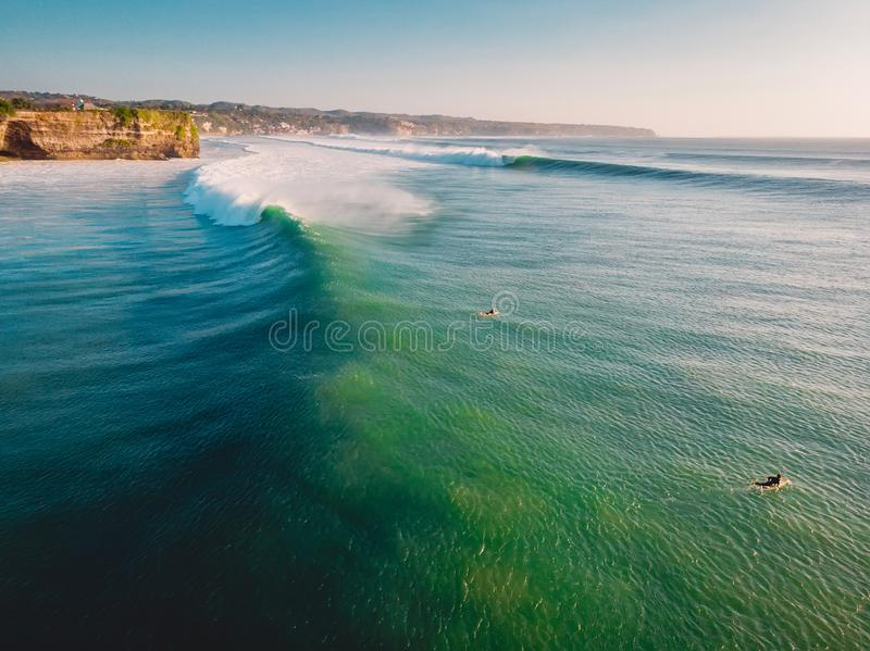 Aerial view of big perfect waves in ocean. Biggest wave and surfer in Bali. Aerial view of big perfect waves in ocean. Biggest wave and surfer royalty free stock images