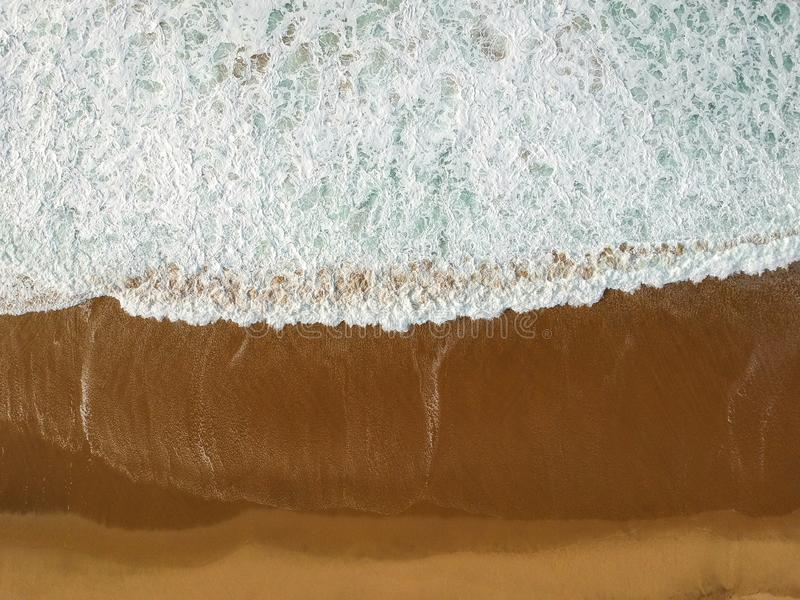 Aerial view of a big sandy beach with waves . Portuguese coastline royalty free stock photography