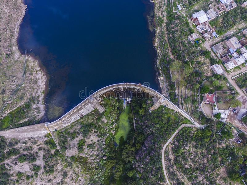 Aerial view of a dam in a coutryside of México. Aerial view of a big structure of a dam in a coutryside of México, and blue water royalty free stock photo