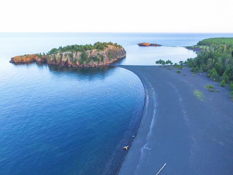 Aerial view of Black Beach of Lake Superior. Showing a beach penninsula and island royalty free stock photography