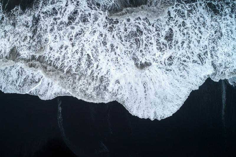 Aerial view of Black sand beach and ocean waves in Iceland.  stock images