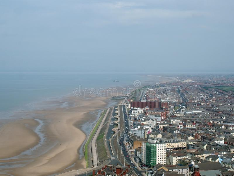 Aerial view of blackpool looking south showing the beach at low tide with the roads and buildings of the town and coast stock photography