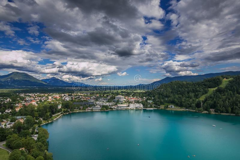 Aerial view of the Bled city resorts, hotels, houses, parks and beaches situated on the bank of the Bled lake stock photo