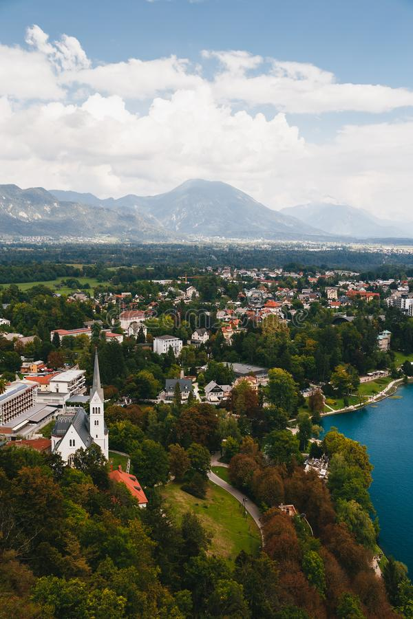 Aerial view of the Bled city, St. Martin`s Parish Church, resorts, hotels, houses, parks and beaches situated on the. Bank of the Lake Bled, surrounded by stock images