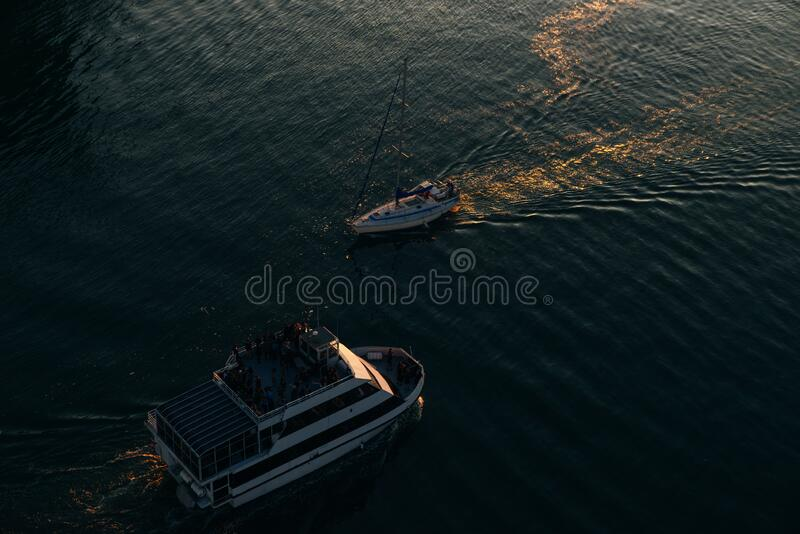 Aerial view of the boat in clear blue water at sunset in summer. Vancouver, canada.  royalty free stock photo