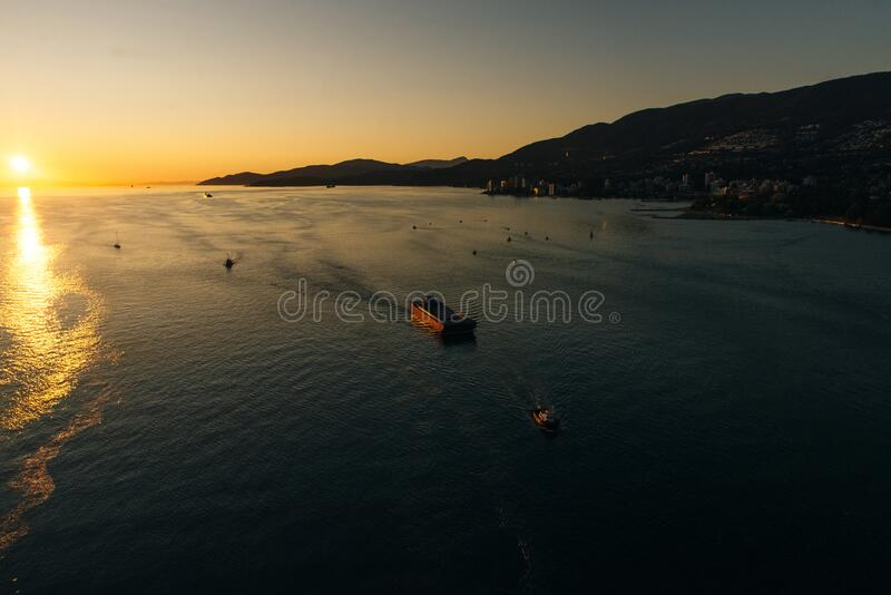 Aerial view of the boat in clear blue water at sunset in summer. Vancouver, canada.  royalty free stock images