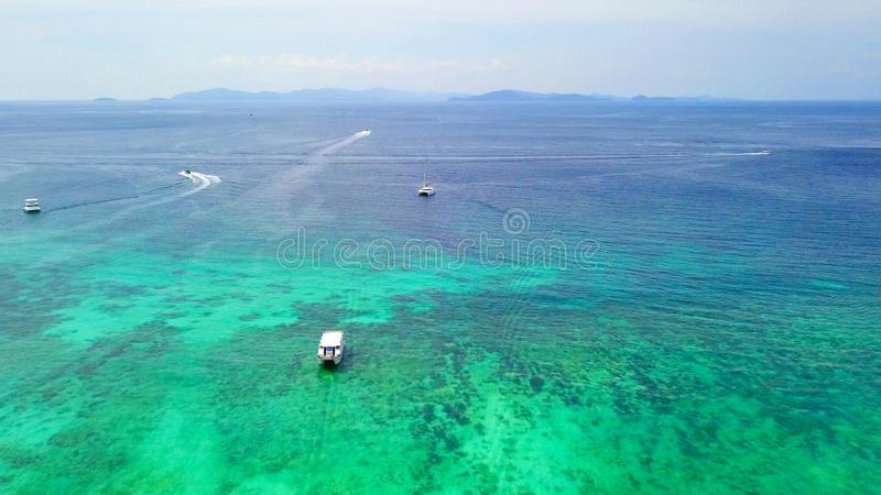 Aerial view of boats with clear blue turquoise seawater, Andaman sea in Phuket island in summer season, Thailand. Water in ocean stock photos