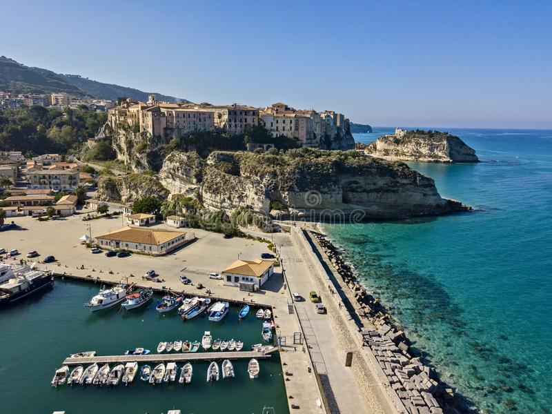 Aerial view of boats moored at the Port of Tropea, Calabria, Italy. Houses overlooking the sea stock images