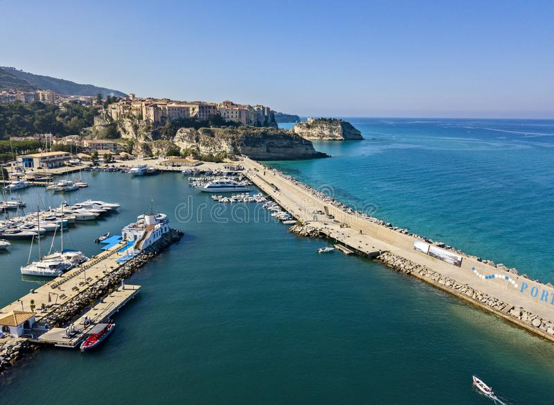 Aerial view of boats moored at the Port of Tropea, Calabria, Italy. Houses overlooking the sea stock photos