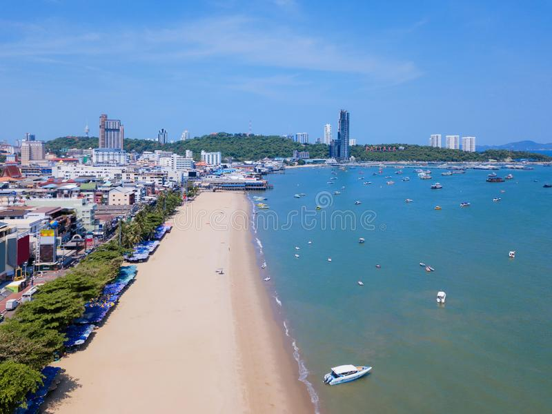 Aerial view of boats in Pattaya sea, beach in summer, and urban city with blue sky for travel background. Chon buri Province, royalty free stock images