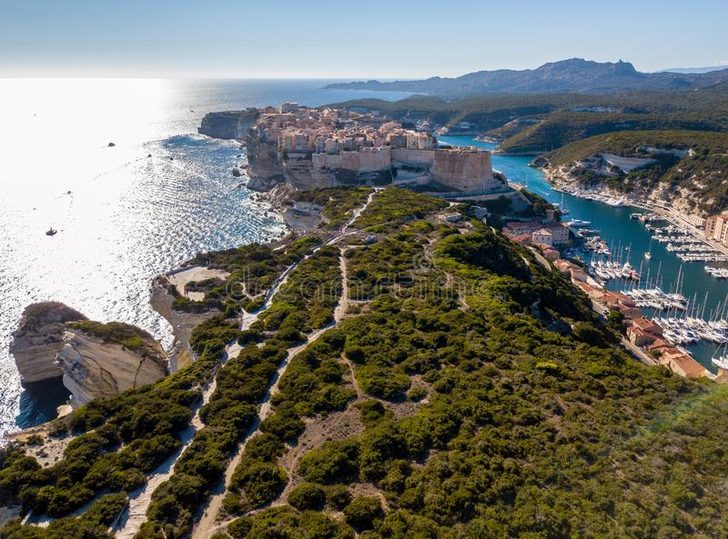 Aerial view of Bonifacio old town built on cliffs of white limestone, cliffs. Harbor. Corsica, France royalty free stock image