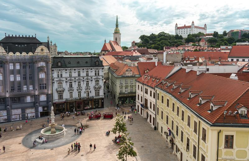 Aerial view of Bratislava old town: Bratislava Castle, Main Square and St. Martin`s Cathedral. With beautiful cloudy sky royalty free stock photos
