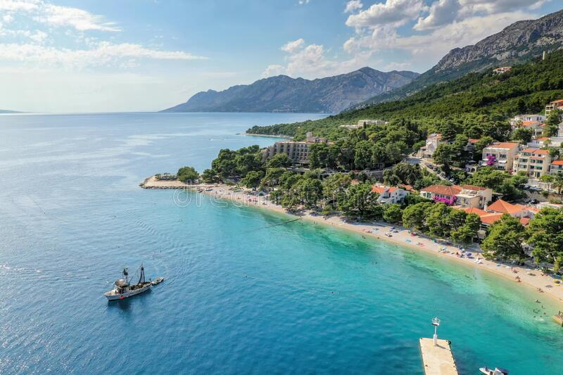 Aerial view of famous Brela with beach and fishing boat in Dalmatia, Croatia royalty free stock images
