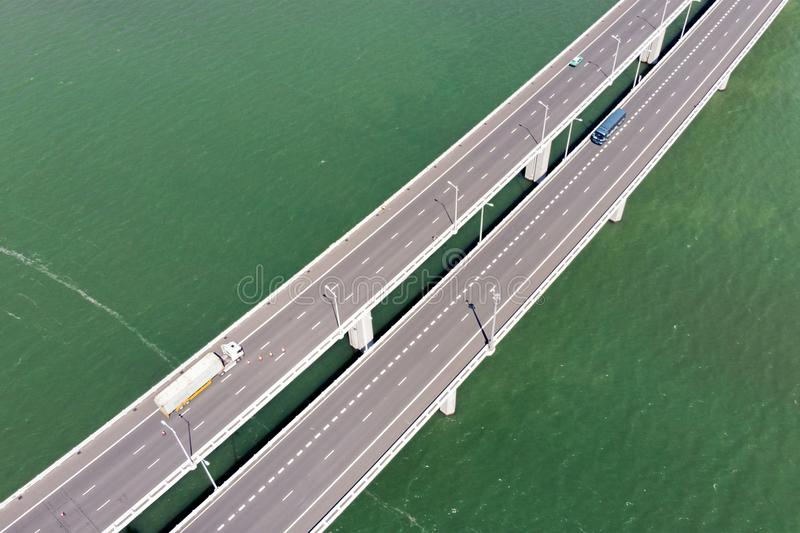 Aerial View of Bridge Over The Reservoir and Vehicles royalty free stock photos