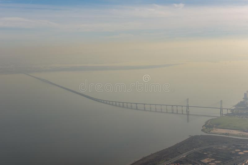 Aerial view of the bridge on river Tejo at Lisbon, Portugal royalty free stock photo