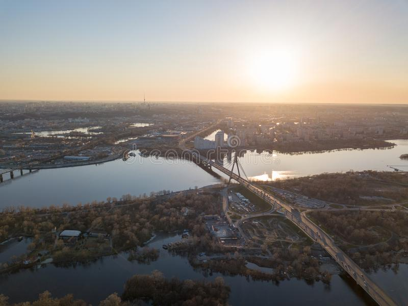 Aerial view on kiev city at sunset. The north bridge over the Dnieper River royalty free stock photo