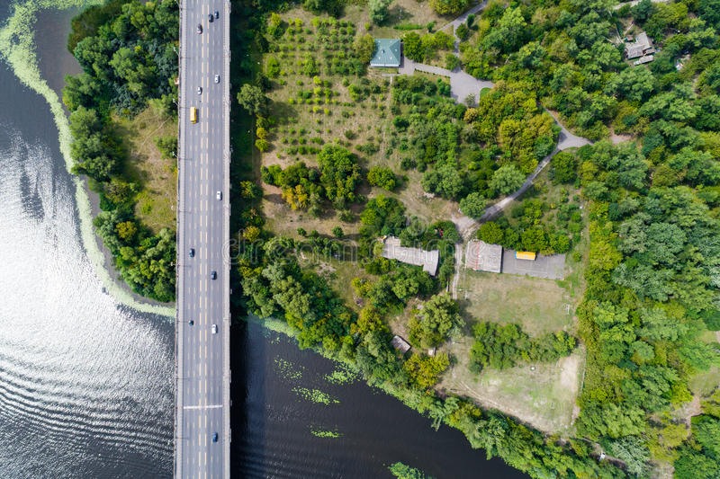 Aerial view of the bridge and the road over the Dnepr River over a green island in the middle of the river. Kiev, Ukraine royalty free stock image