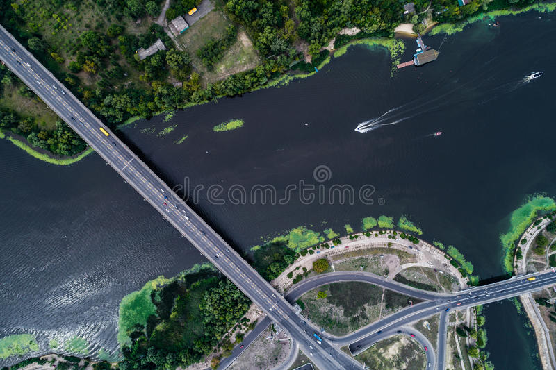 Aerial view of the bridge and the road over the Dnepr River over a green island in the middle of the river. Kiev, Ukraine stock photos