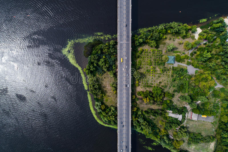 Aerial view of the bridge and the road over the Dnepr River over a green island in the middle of the river. Kiev, Ukraine royalty free stock photo