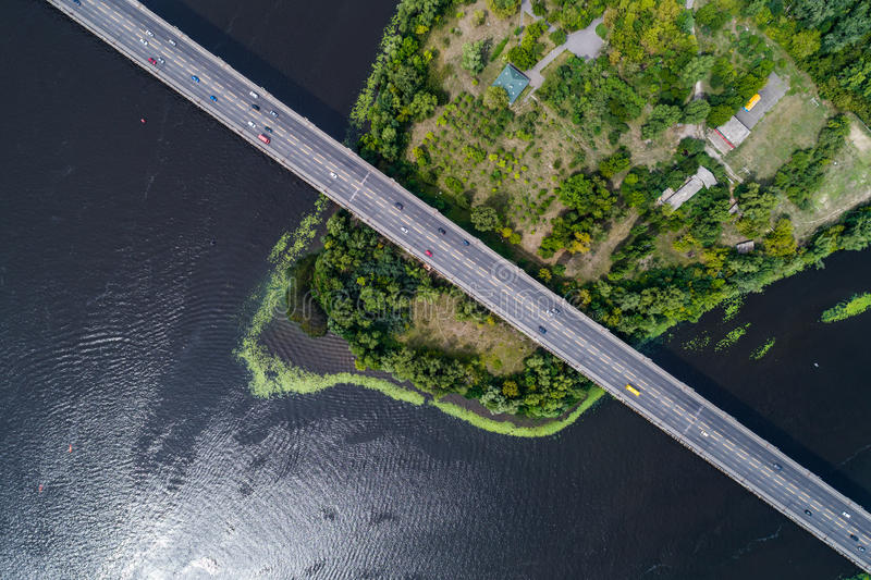 Aerial view of the bridge and the road over the Dnepr River over a green island in the middle of the river. Kiev, Ukraine royalty free stock images