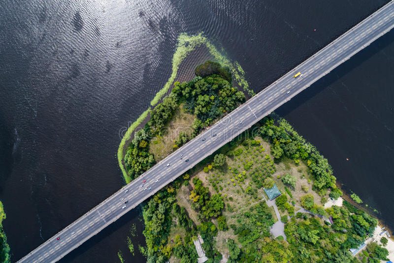 Aerial view of the bridge and the road over the Dnepr River over a green island in the middle of the river. Kiev, Ukraine royalty free stock photography