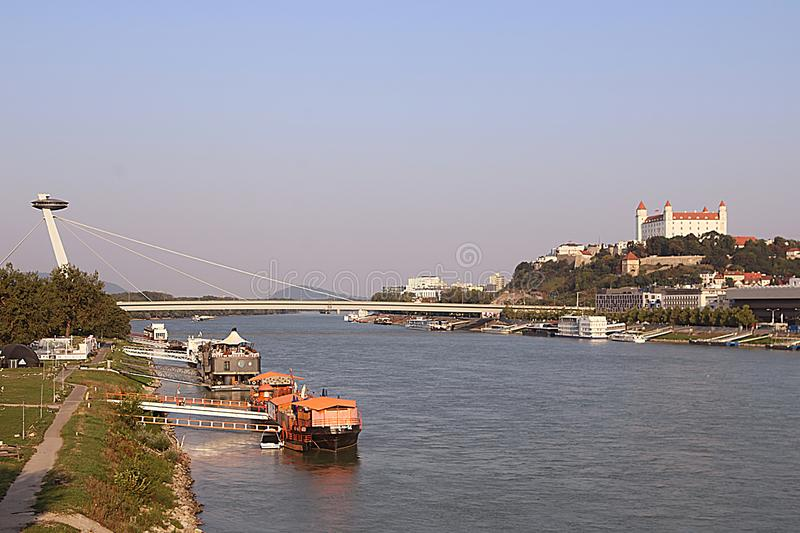 Aerial view of Bridge SNP and UFO observation deck left, river Danube and Bratislava castle right, Bratislava, Slovakia royalty free stock photos