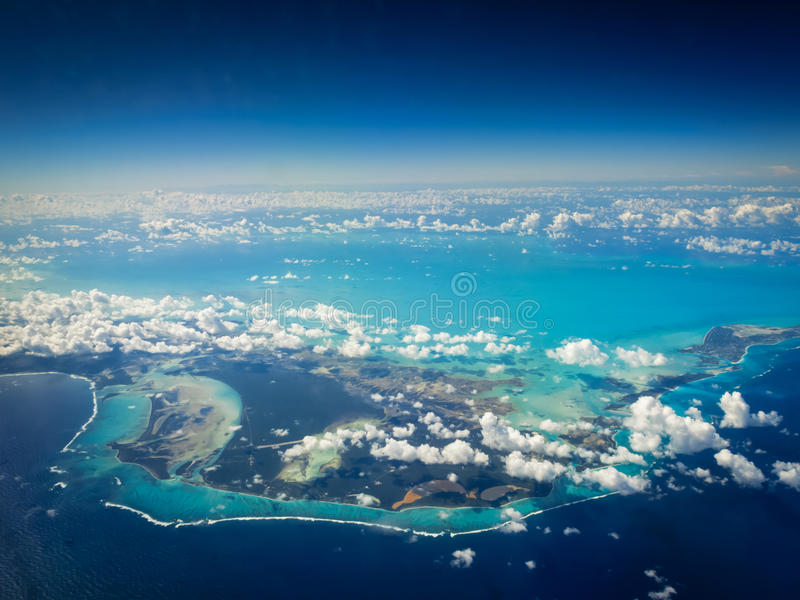 Aerial view of bright turquoise shallow water around Caribbean islands. Aerial view of Caribbean islands surrounded by bright turquoise water and a coast contour stock photography