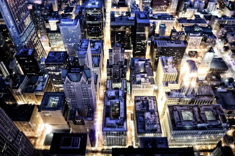 Aerial View Of Building With Lights On During Night Time Free Public Domain Cc0 Image