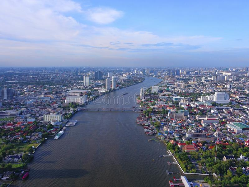Aerial view of buildings with Chao Phraya River in transportation concept. Bangkok skyline background, Urban city in downtown area. At sunset, Thailand stock photography