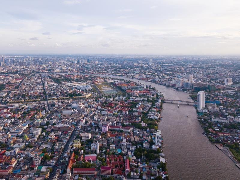 Aerial view of buildings with Chao Phraya River in transportation concept. Bangkok skyline background, Urban city in downtown area. At sunset, Thailand stock photo