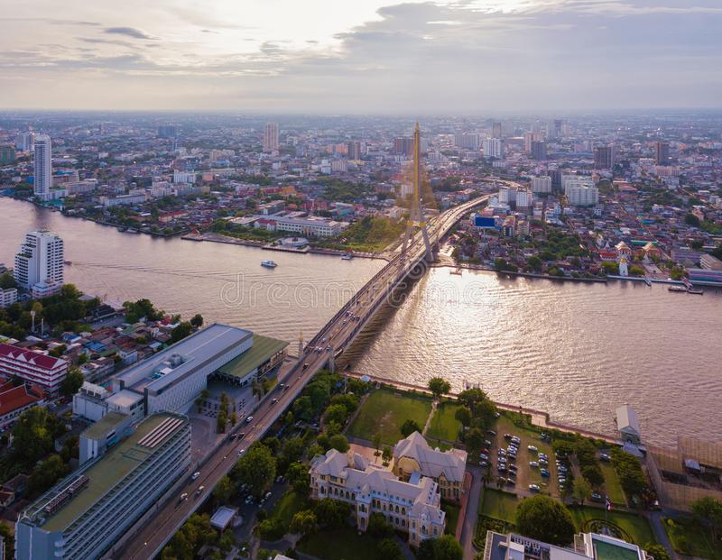 Aerial view of buildings with Chao Phraya River in transportation concept. Bangkok skyline background, Urban city in downtown area. At sunset, Thailand royalty free stock photos