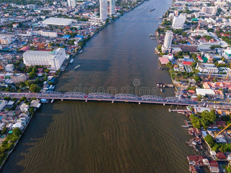 Aerial view of buildings with Chao Phraya River in transportation concept. Bangkok skyline background, Urban city in downtown area. At sunset, Thailand royalty free stock photo