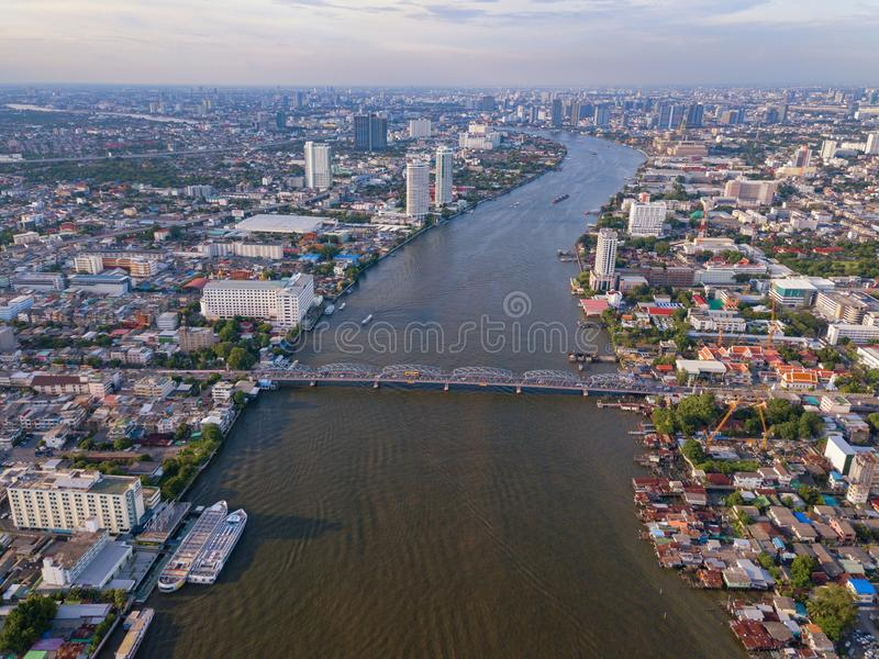 Aerial view of buildings with Chao Phraya River in transportation concept. Bangkok skyline background, Urban city in downtown area. At sunset, Thailand stock photos
