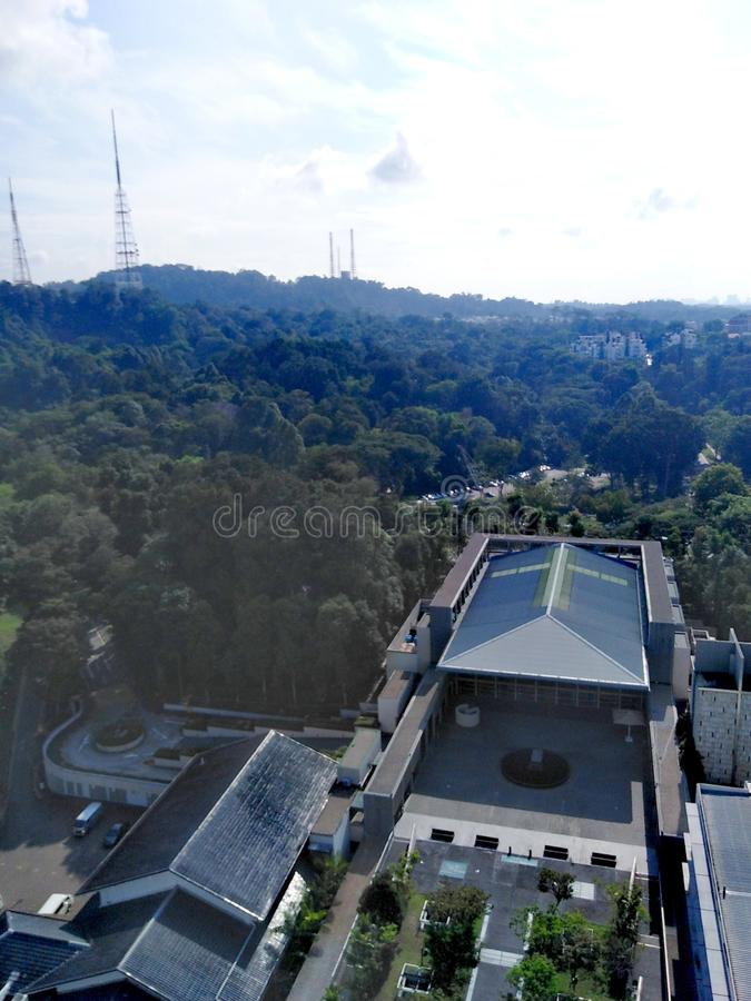 Aerial view of Bukit Batok nature park in Singapore. Aerial view of bukit batok nature park. from above st mary of the angels church. holy, cross, symbol stock photography