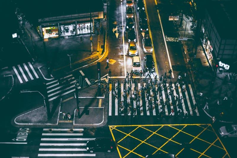 Aerial View of Bunch of People Walking on White Pedestrian Lane during Night royalty free stock photos