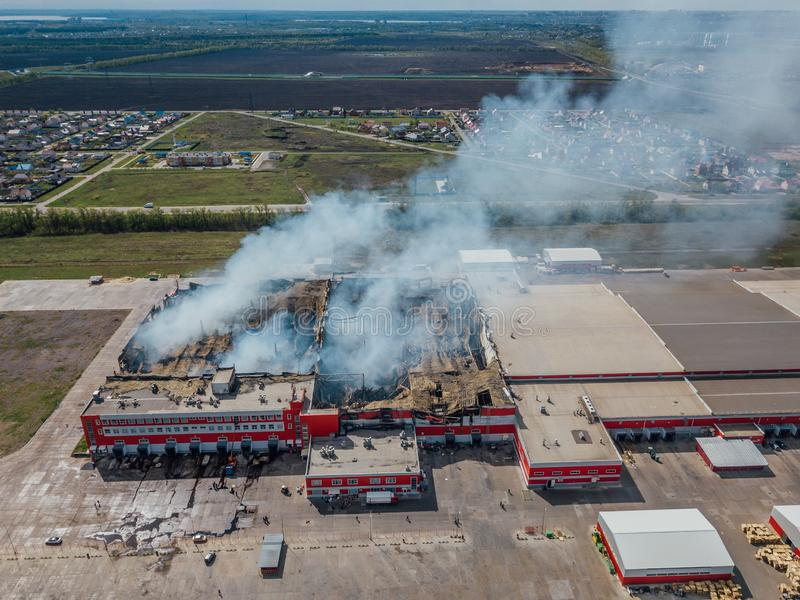 Aerial view of burning industrial distribution warehouse.  stock image
