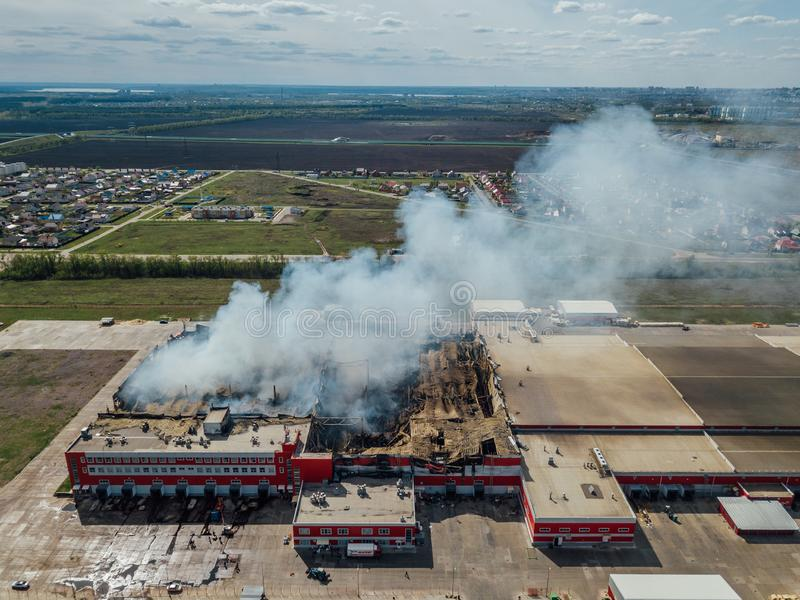 Aerial view of burning industrial distribution warehouse.  royalty free stock image