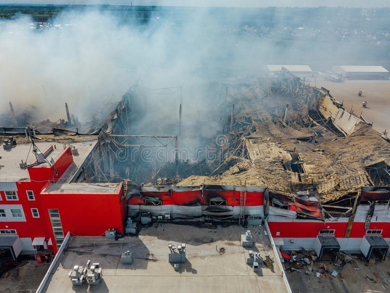 Aerial view of burning industrial distribution warehouse.  royalty free stock photography
