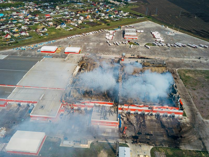 Aerial view of burning industrial distribution warehouse.  stock photography