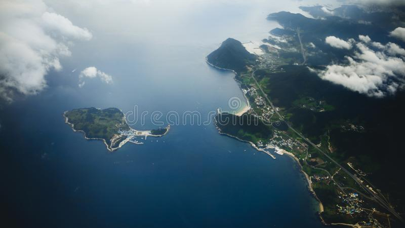 Aerial view of Busan city from above with clouds in South Korea royalty free stock photo