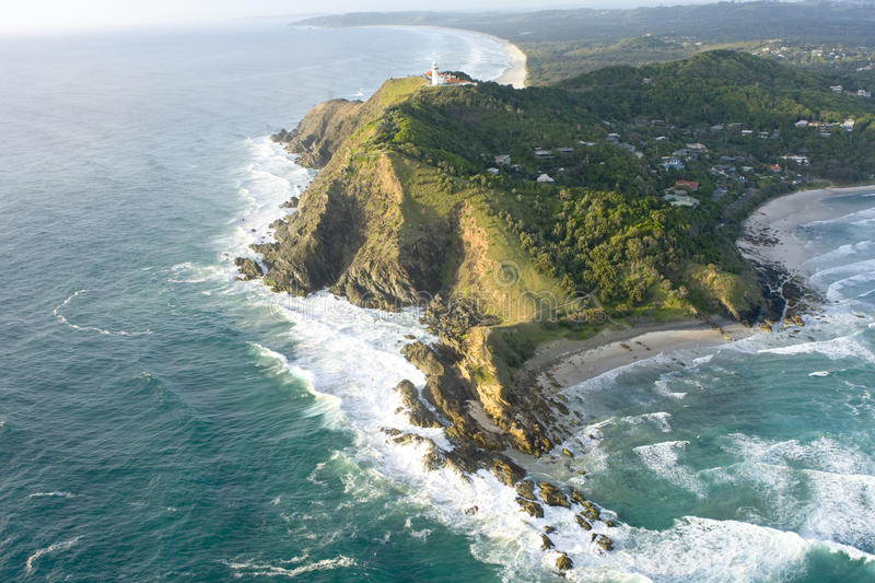 Aerial view of Byron Bay. Aerial view of waves breaking on Byron Bay with lighthouse on cliffs, New South Wales, Australia royalty free stock photo